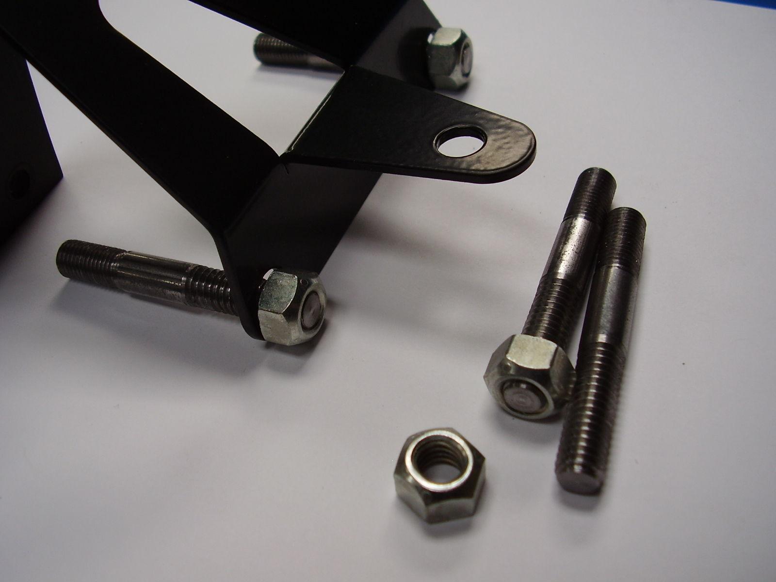 Throttle cable return spring bracket studs